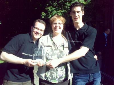 Lachende Sieger aus Tübingen: Volker Tjaden, Pauline Leopold und Peter Croonenbroeck